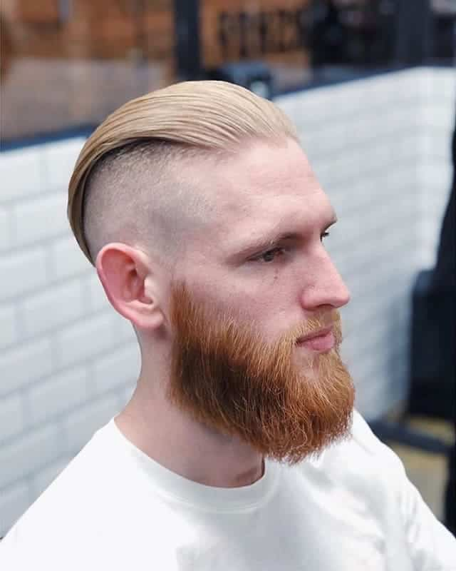 slick back bald fade with disconnected undercut