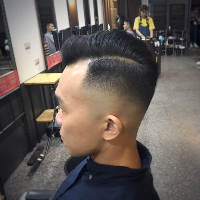 slick back hair with side part and fade