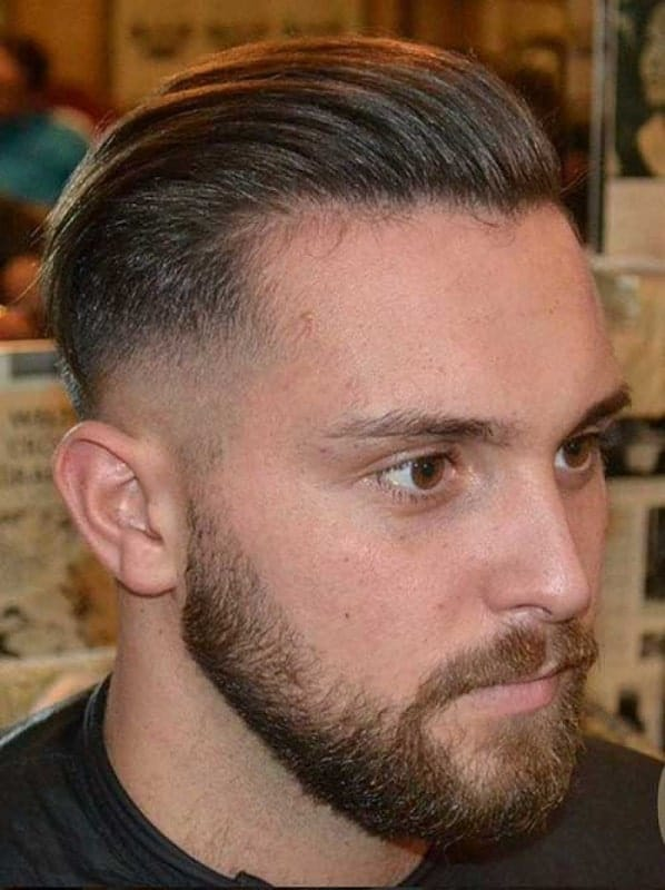 slick back hairstyle with faded sides