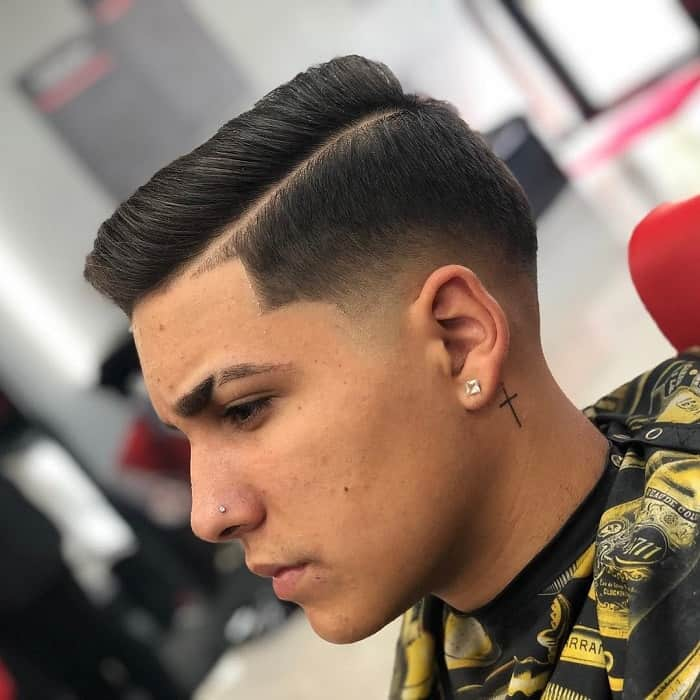 taper fade blowout hair with hard part