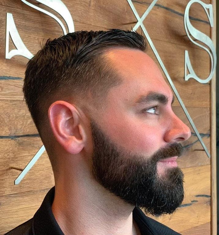 taper fade with side swept hair and beard