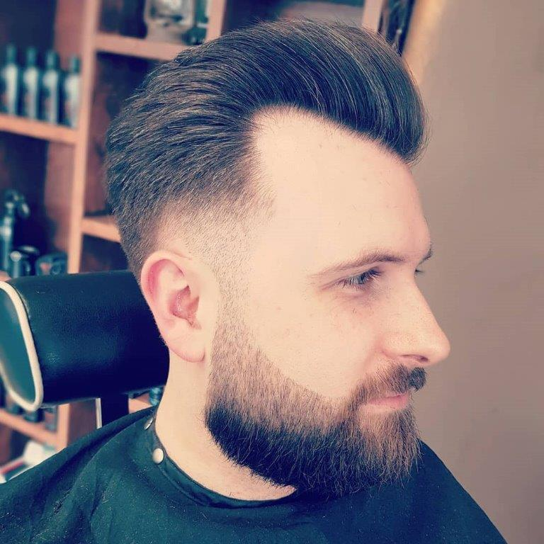 guy with taper fade and beard