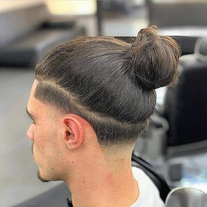 man bun with taper fade for long hair