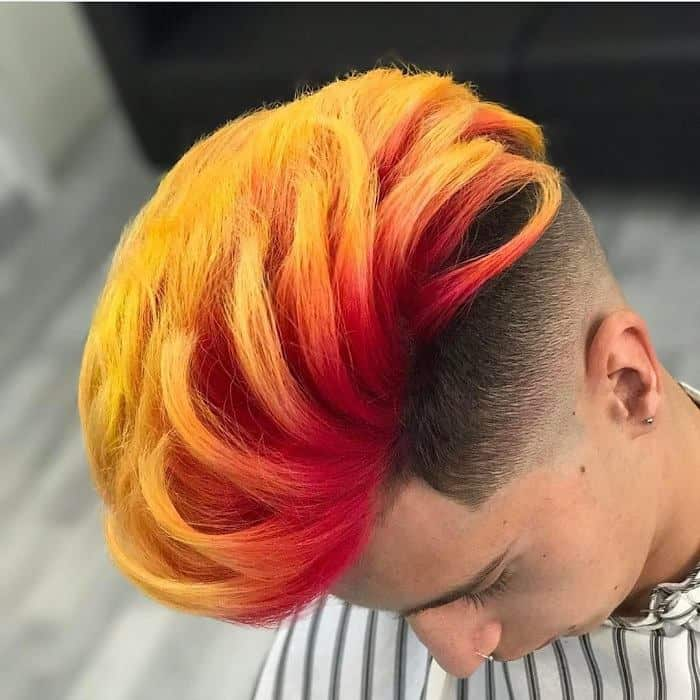 tapered low fade with fiery long hair
