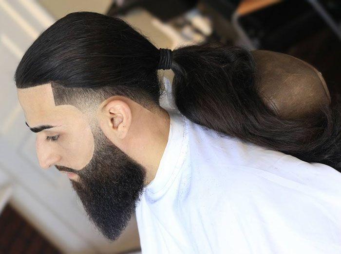 long ponytail with taper fade