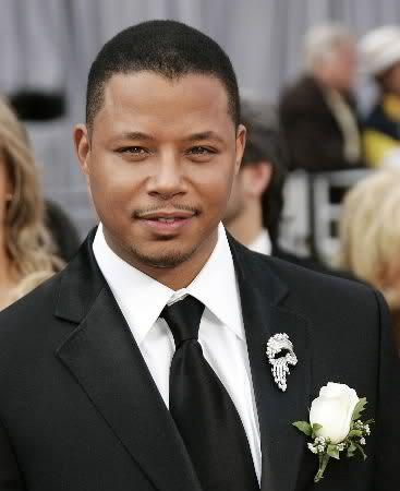 Photo of Terrence Howard short hair with thin mustache and beard.