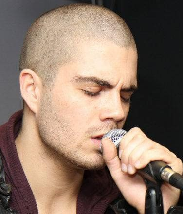 Image of Max George shaved head.
