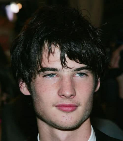 Picture of Tom Sturridge bead head hairstyle.