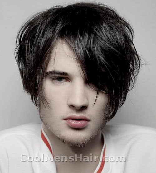 Photo of Tom Sturridge hair with bangs covered one eye.