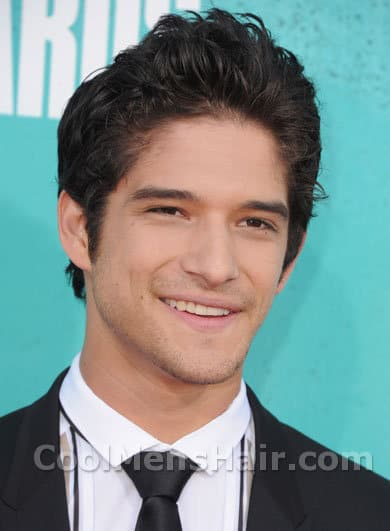 Photo of Tyler Posey wavy hair with short sides and back.