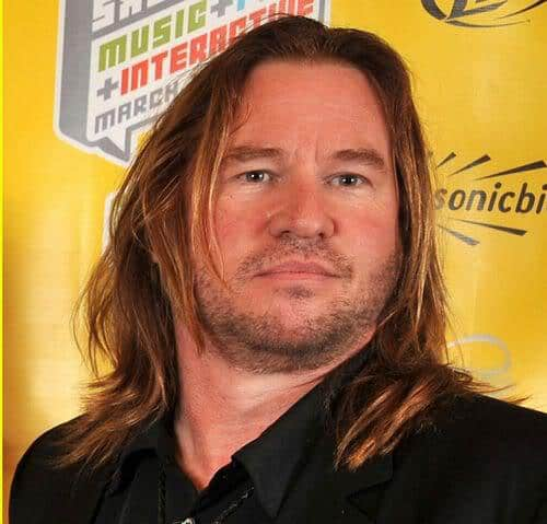 Photo of Val Kilmer long hairstyle.