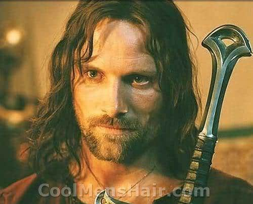 Picture of Viggo Mortensen as Aragorn with long hairstyle.