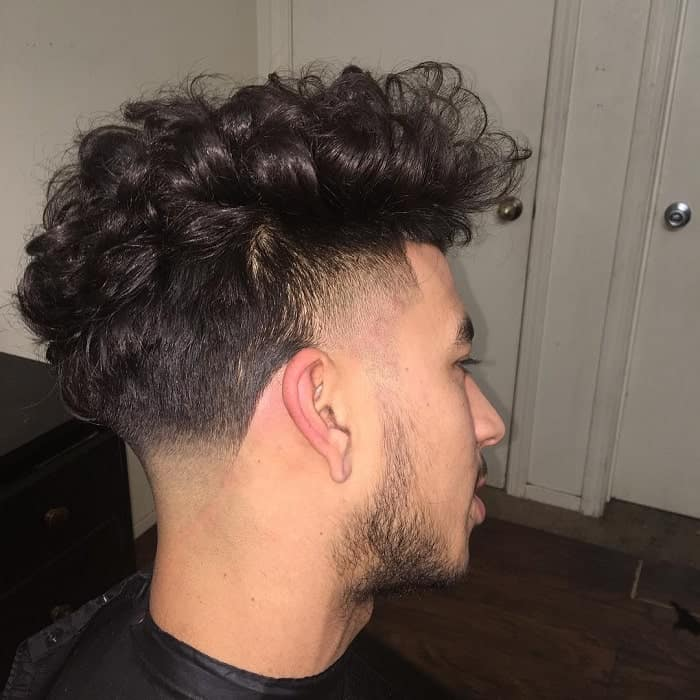 wavy hair with taper fade