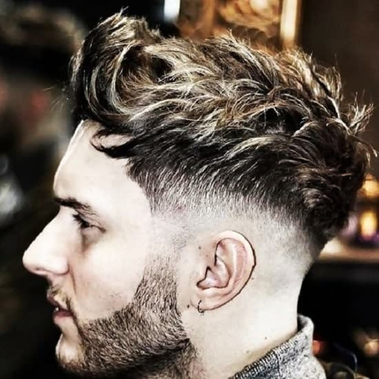 medium fade haircuts for men with wavy hair