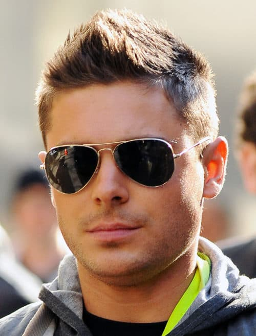 Photo of Zac Efron faux-hawk hairstyle.