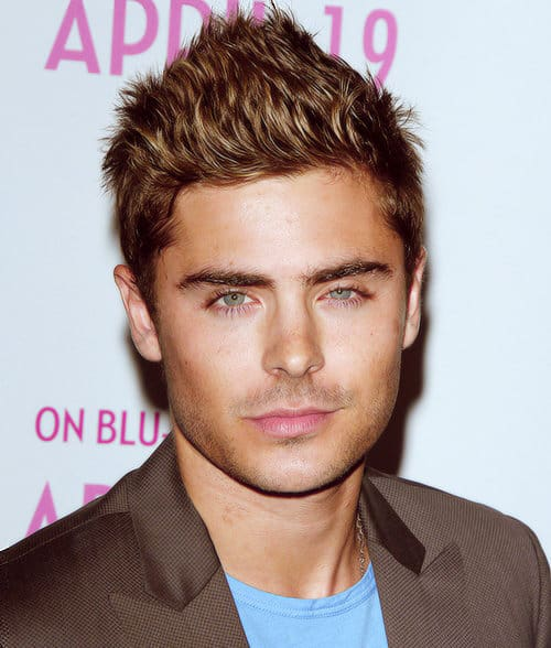 Photo of Zac Efron short spiky hair.