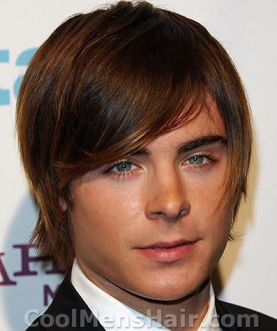 Image of Zac Efron straight shaggy hairdo.