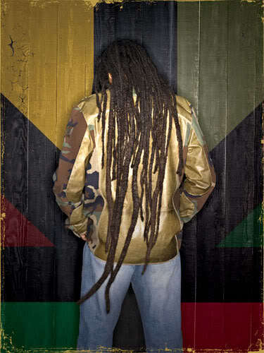 Picture of Ziggy Marley dreadlock hairstyle.